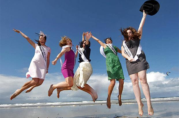 Rose of Tralee contestants Noreen Feeney, Sunderland, Ruth Levins, Germany, Elaine Rael, Dubai, Clare Kambamettu, London and Adrienne Hussey, Texas, take to the air while enjoying the good weather on Banna Strand. Photo: Frank McGrath
