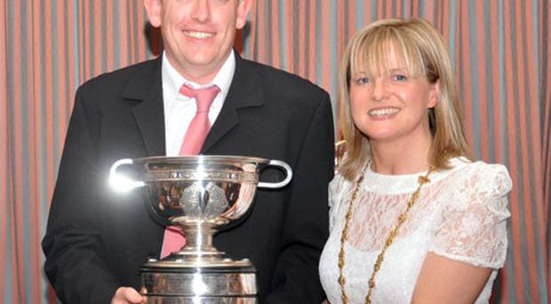 Michael Fahy Junior accepts the Lord Mayor's Cup from Councillor Deirdre Heney, who was representing the Lord Mayor of Dublin at the trophy presentation held in Clontarf golf club.