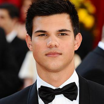 Taylor Lautner is sueing a trailer dealership
