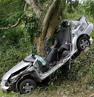The remains of the car pictured at the scene of the accident near Killarney. Photo: Frank McGrath