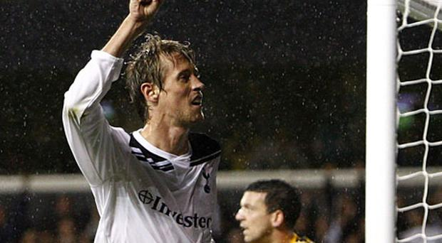 Tottenham's Peter Crouch celebrates his side's third goal during last night's Champions League qualifier. Photo: PA