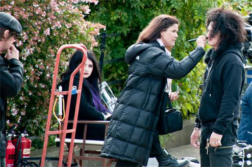 Bono's daughter Eve Hewson looks on while Sean Penn is made up during a break from filming in Dublin yesterday