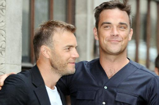 Gary Barlow and Robbie Williams. Photo: PA