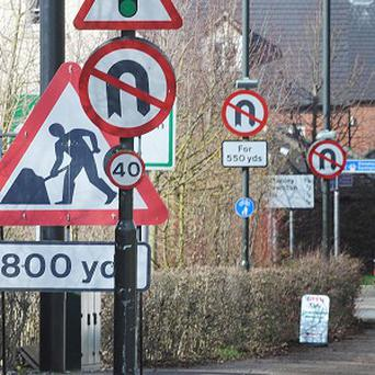 Councils are being urged to cut down on the number of street signs