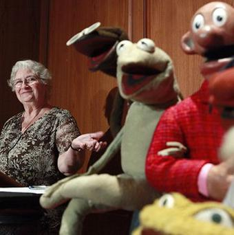 Jane Henson with some of Jim Henson's early puppets, including the original Kermit (AP)