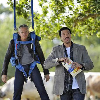 Lionel Richie stars in the new Walkers advert with Gary Lineker