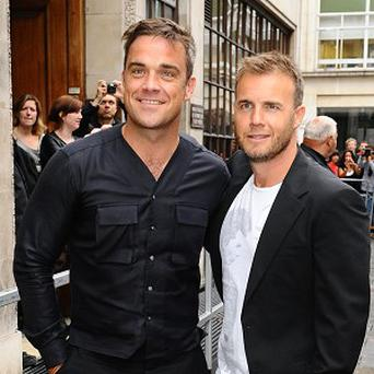 Robbie Williams and Gary Barlow have unveiled their single Shame