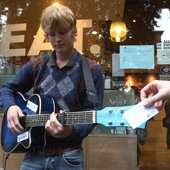 Busker Peter Buffery with his specially designed guitar accepting contactless card payments