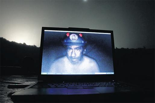Signal of hope: A computer screen shows one of the miners trapped underground in a copper and gold mine inside the mine at Copiapo, some 725km north of Santiago, Chile. Photo: Ivan Alvarado