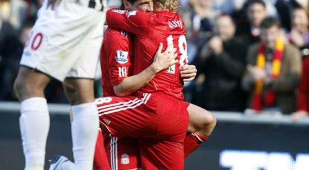 Liverpool's Fernando Torres (left) celebrates his goal with Dirk Kuyt during the Premier League match at Anfield. Photo: PA