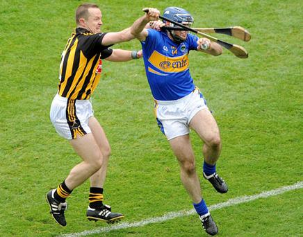 Kilkenny's Michael Kavanagh tackles Eoin Kelly of Tipperary during last years All-Ireland hurling final. Photo: Ray McManus / Sportsfile