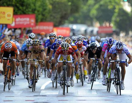 FDJ rider Yauheni Hutarovich (right) crosses the finish line to win the second stage of the Tour of Spain between Sevilla and Marbella yesterday. Photo: Reuters
