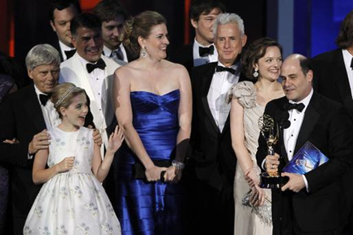 Matthew Weiner, right, along with cast members, accepts Emmy award for outstanding drama series for Mad Men. Photo: PA