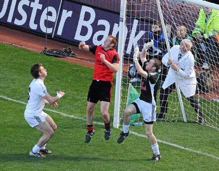 Down's Benny Coulter in the square alongside Kildare's Emmet Bolton and goalkeeper Shane McCormack. Photo: Brendan Moran / Sportsfile