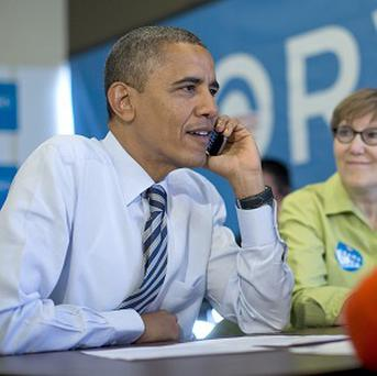 Barack Obama calls to thank volunteers in Wisconsin (AP)