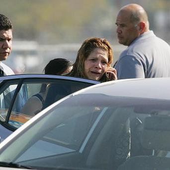 A woman cries after hearing about a workplace shooting in Fresno, California (AP)
