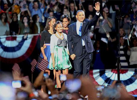 President Obama and his family on stage during his election night victory rally