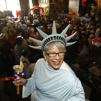 A US citizen reacts with delight at a party to celebrate the US elections in Mumbai, India (AP)