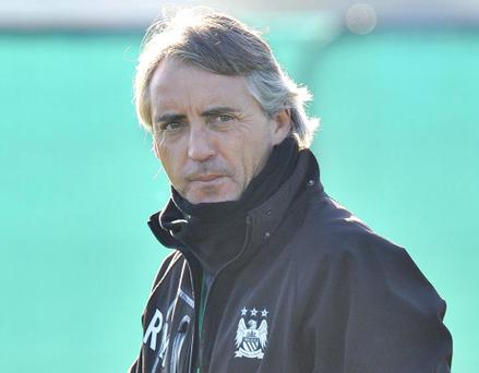 Manchester City manager Roberto Mancini during a training session at Carrington, Manchester. PRESS ASSOCIATION Photo. Picture date: Monday November 5, 2012. Manchester City face Ajax in their UEFA Champions League match tomorrow. See PA story SOCCER Man City. Photo credit should read: Martin Rickett/PA Wire.