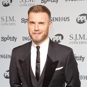 Gary Barlow arrives at the 2012 Music Industry Trust Awards