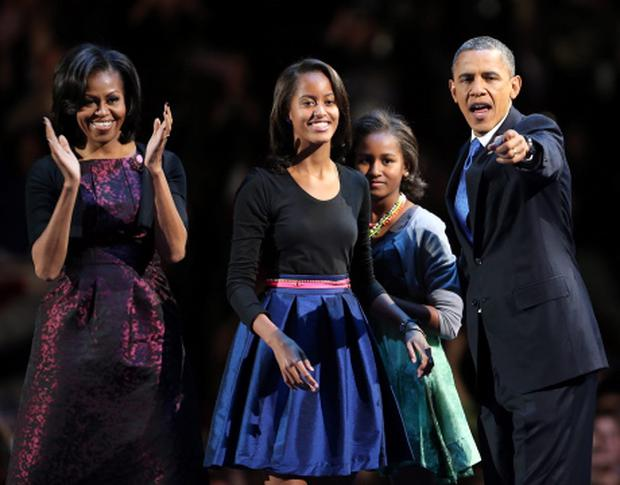 CHICAGO, IL - NOVEMBER 06: U.S. President Barack Obama stands on stage with first lady Michelle Obama and daughters Sasha and Malia after his victory speech on election night at McCormick Place November 6, 2012 in Chicago, Illinois. Obama won reelection against Republican candidate, former Massachusetts Governor Mitt Romney. (Photo by Spencer Platt/Getty Images)