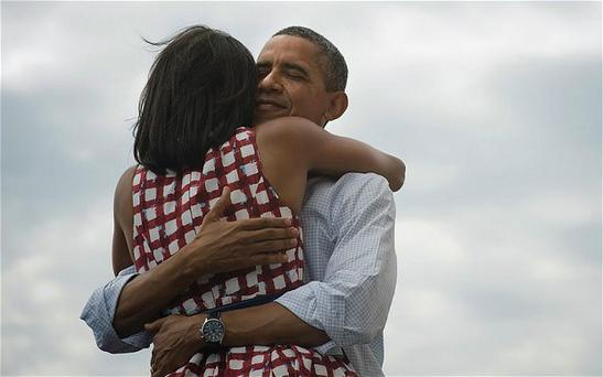 The picture of Barack and Michelle Obama, captioned 'Four more years.'