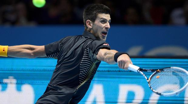 Serbia's Novak Djokovic hits a return to Britain's Andy Murray during their men's singles tennis match at the ATP World Tour Finals in the O2 Arena in London November 7, 2012. REUTERS/Dylan Martinez (BRITAIN - Tags: SPORT TENNIS)