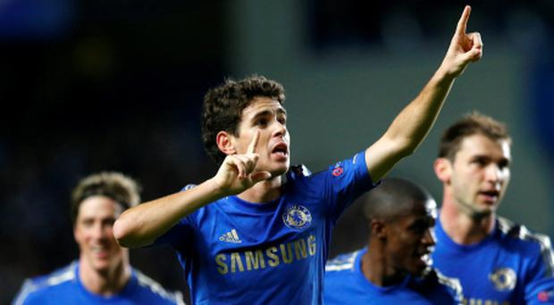 Chelsea's Oscar celebrates after scoring his wonder goal against Shakhtar Donetsk