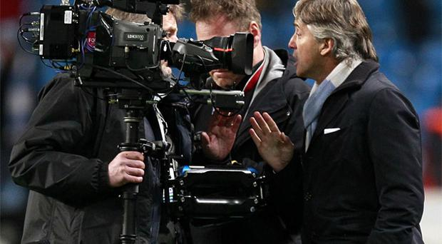 Roberto Mancini remonstrates with a camera man after a frustrating finish to Tuesday night's Champions League tie