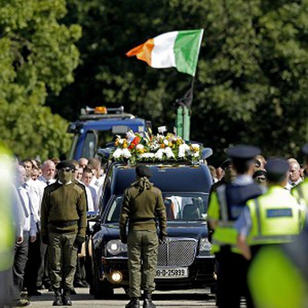 Mourners attending the funeral of Alan Ryan in Dublin