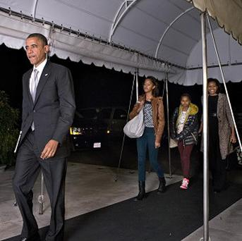 Barack Obama, daughters Malia, second from left, and Sasha and first lady Michelle Obama, return to the White House for the first time since his victory (AP Photo)