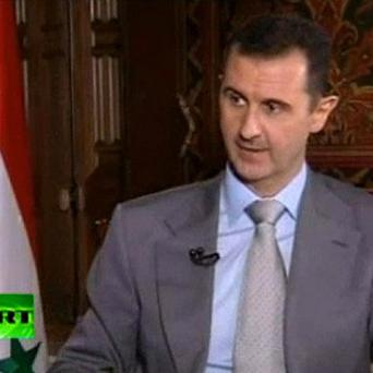 Syrian President Bashar Assad telling Russia Today TV that he will never leave Syria. (AP)