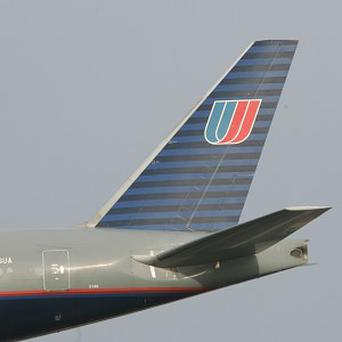 A United Airlines flight was escorted by fighter jets to Washington DC after a passenger started to pray in the aisle
