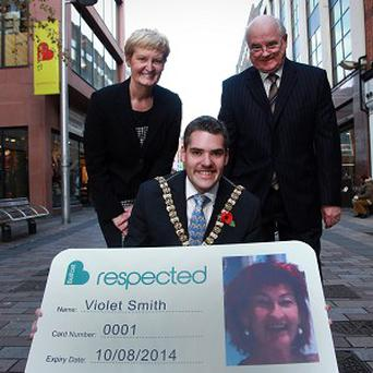 Lord Mayor Gavin Robinson with Billy McGivern, Belfast City Centre Management and Anne O'Reilly, of Age NI, at the launch of the Be Respected initiative (Phil Smyth/PA)