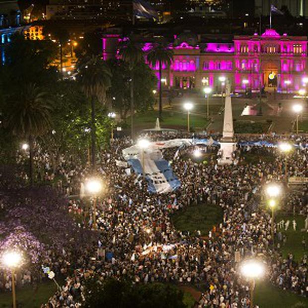 Protesters demonstrate against Argentina's president Cristina Fernandez in front of the government house in Buenos Aires (AP pic)
