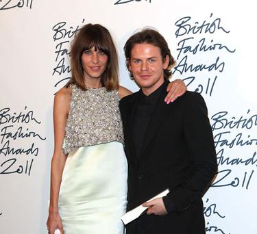 Christopher Kane, pictured here with Alexa Chung, is rumoured to be taking over at Balenciaga