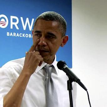 US president Barack Obama wipes away tears as he thanks members of his campaign staff and volunteers after he won re-election (AP pic)