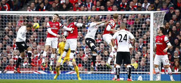 Fulham's Dimitar Berbatov (left) scores his first goal against Arsenal