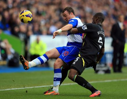 READING, ENGLAND - NOVEMBER 10: Noel Hunt of Reading holds off Sebastien Bassong of Norwich during the Barclays Premier League match between Reading and Norwich City at the Madejski Stadium on November 10, 2012 in Reading, England. (Photo by Richard Heathcote/Getty Images)