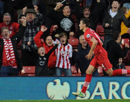 SOUTHAMPTON, ENGLAND - NOVEMBER 10: Morgan Schneiderlin of Southampton celebrates his goal during the Barclays Premier League match between Southampton and Swansea City at St Mary's Stadium on November 10, 2012 in Southampton, England. (Photo by Tom Dulat/Getty Images)