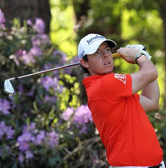 Rory McIlroy, pictured, is five strokes adrift of leader Thomas Bjorn