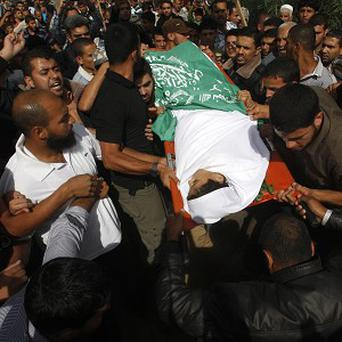 People carry the body of Ahmed Abu-Daqa, 11, during his funeral in Khan Younis, southern Gaza Strip (AP)