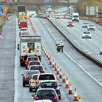 PSNI detectives revisit the scene of the David Black killing on the M1 motorway as they appeal for information