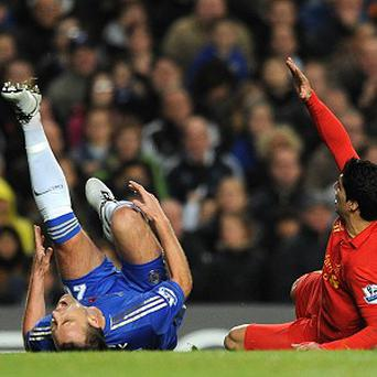 John Terry, left, was stretchered off after a clash with Luis Suarez, right