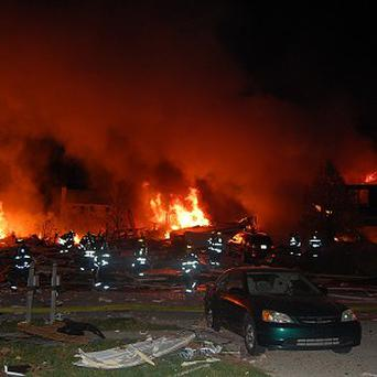 Firefighters at the scene of a fatal explosion and blaze in the Richmond Hill area of Indianapolis (AP/Indianapolis Fire Department)