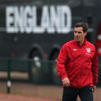 Gary Neville, pictured, has been criticised by Carlos Tevez
