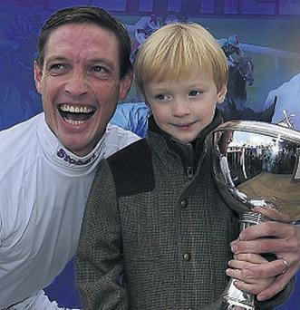 Richard Hughes celebrates his title success with son Harvey at Doncaster.