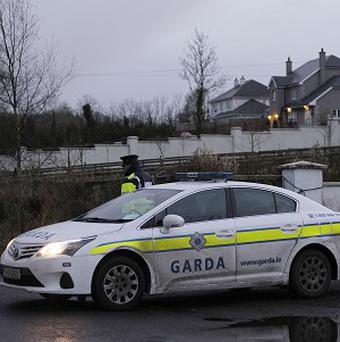 Gardai at the scene after the body of John Kerins was discovered inside a house in Cornaveagh, near Bailieborough, Co Cavan