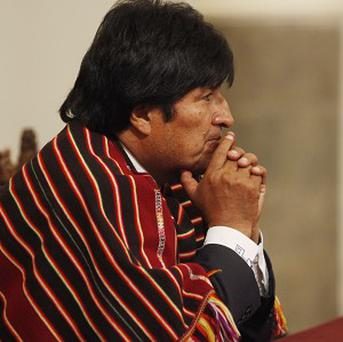 Boliviam president Evo Morales wearing the type of poncho he claims has boosted his personal wealth (AP)