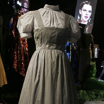 The blue-and-white gingham pinafore dress worn by Judy Garland in her role of Dorothy for the 1939 film The Wizard Of Oz (AP Photo)